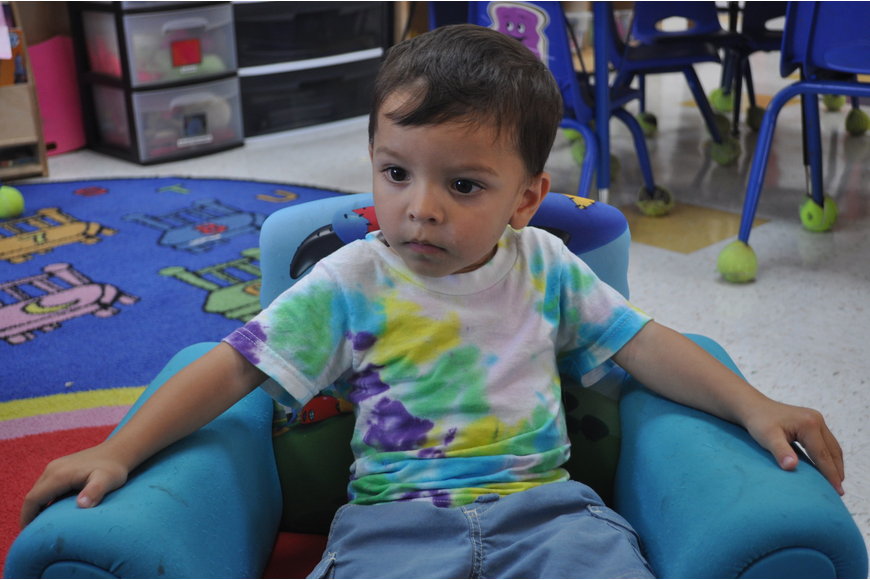 Nick Sharma, 2, secured the best seat in the house for a reading of Curious George.
