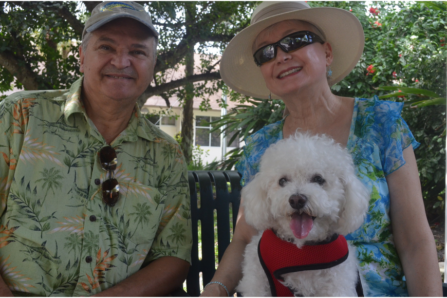 Judy and John Hoover with their 10 – year old Bichon Frisé Baxter