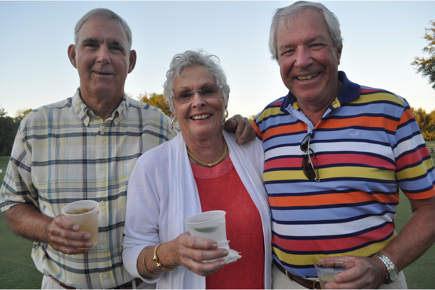 Canadians Tim Peat, winner of the regatta on the lake, his wife, Rita, and Gary Brule