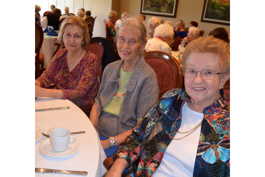 Gal pals Sandy Ciampa, Nancy Page and Marge Jones wait for the fashion show to begin.