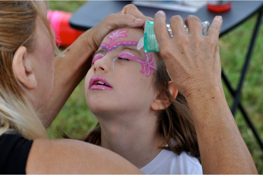 Holly Greer, 6, waits to see her new face for-a-day.