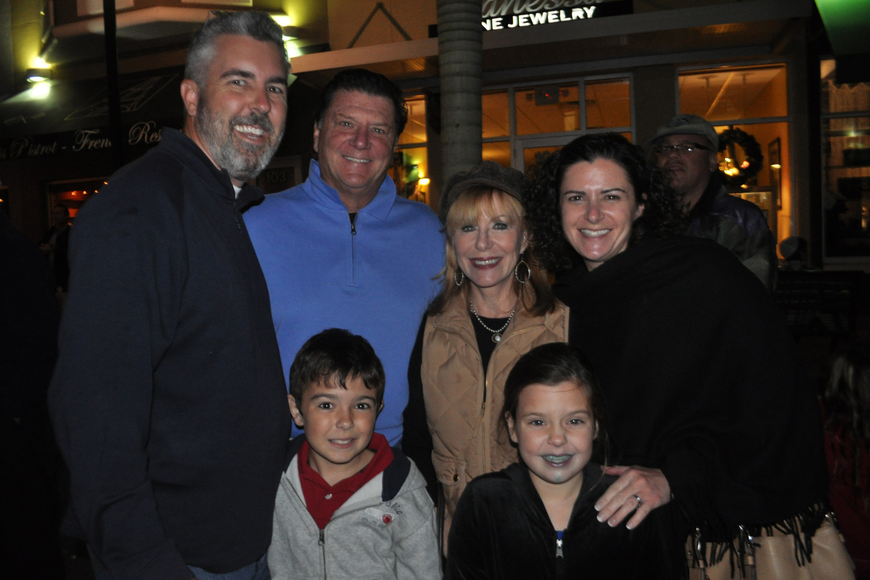 River Strand residents Jack and Gayle Mutchnick, center, came with their family, Ben, Will, Amilia and Maggie Hilton.