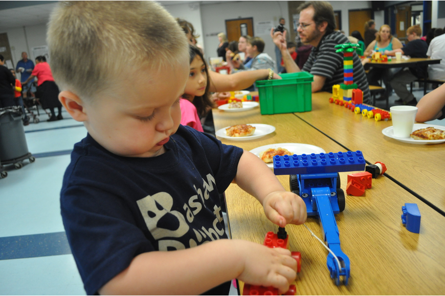 Jarrett Williams, a two-year-old future Bashaw student, worked hard on his Lego creation.