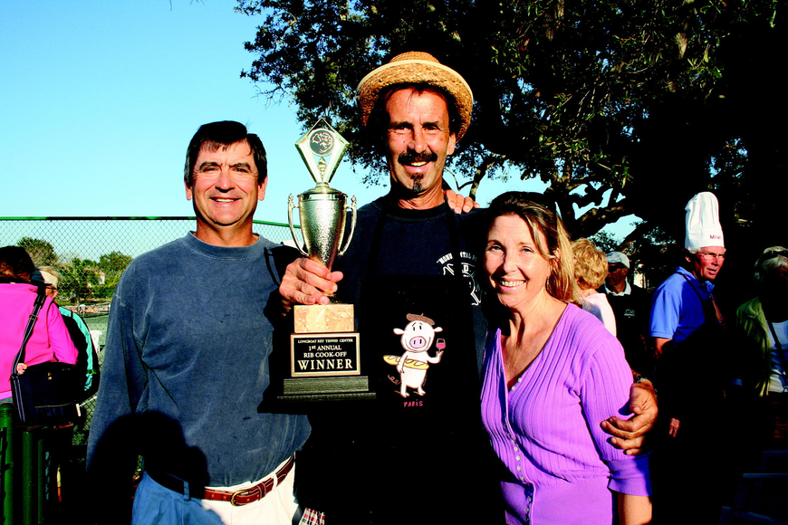 Dave Sparks, left, and Grace Hackett, right, pose with Longboat Key Public Tennis Center Ribfest cook-off winner Tim Fitzpatrick in February.