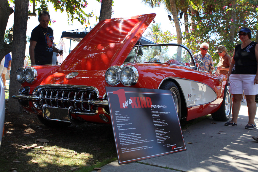 People check out Karl Kudick's 1 uva Kind 1958 Corvette on Saturday, Feb. 19 at the Sarasota Exotic Car Fest in St. Armand's Circle