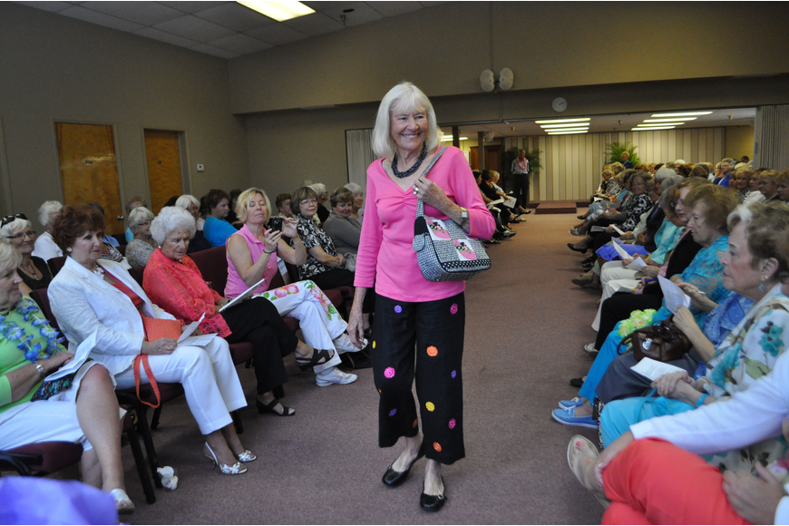 Mardene Eichhorn turned heads in a bright pink top and polka dotted pants.