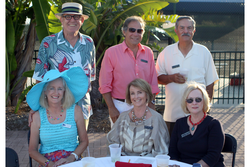 Bill and Annette Lloyd, Mark and Cindy Wolfendale and Lou and Barb Sanandres pose at their table Saturday, May 28 at Bird Key Yacht Club's Memorial Day party.