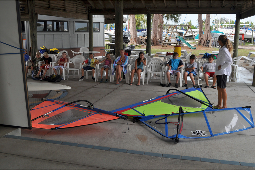 Laurel Kaiser puts out different sails for the campers to try and assemble and disassemble in groups of four Friday, July 8 during the Island Style Water Sports Camp.