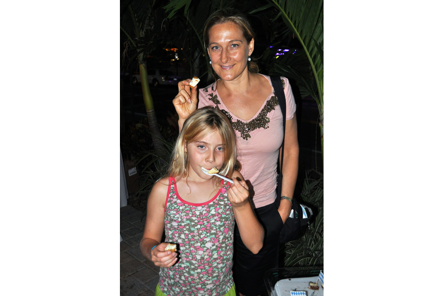 Catherine and Saylor, 8, Ellis enjoy some treats from the A Taste of Germany table Thurday, Oct. 6 during the 11th annual Okto-Paw-Fest at the Daiqiuri Deck on SIesta Key.