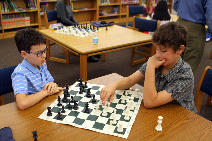 David Jacobs and Dylan Calcorzi play one another, Saturday, Feb. 11, in the library at Phillippi Shores Elementary.