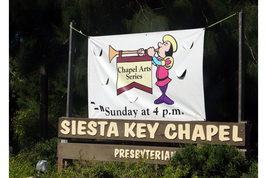 A banner was hung out by the road to let people know that there was a performance happening at Siesta Key Chapel.