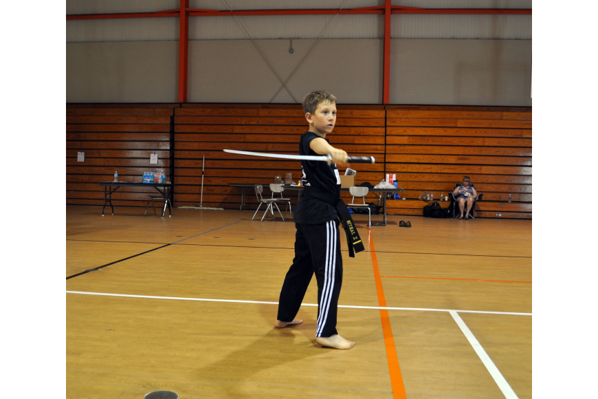Zachary Jarvis practices his weapons kata with a sword.