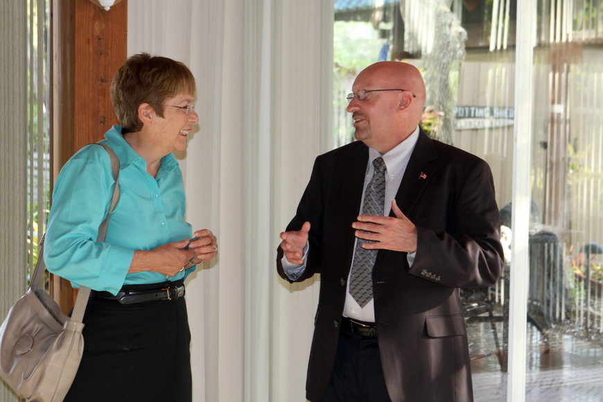 Commissioner Nora Patterson and Brian Slider, Dist. 5, chat with one another, Monday, June 11.