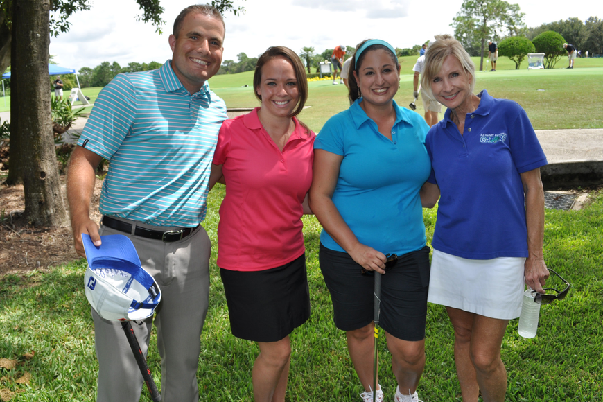 Tyler and Brandi Whitman golfed with Jackie Stark and Gullett Principal Kathy Hayes.