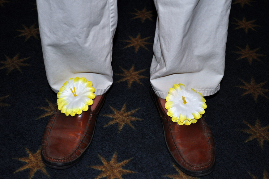 Bill Lloyd decorated his shoes with fake flowers for Bird Key Yacht Club's luau Saturday, Sept. 22.