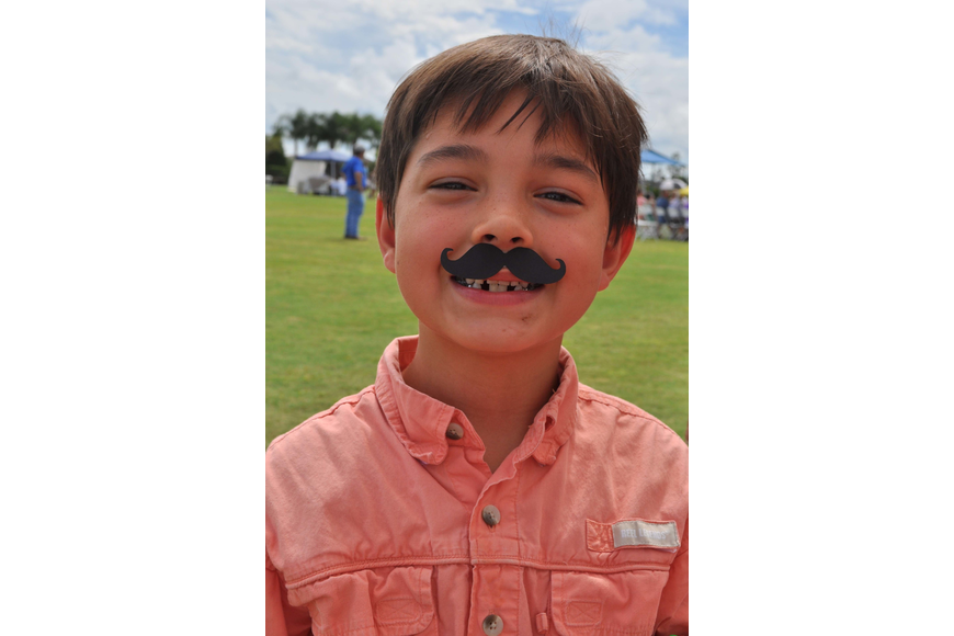 Diego Davila, 8, couldn't resist getting an Italian-inspired mustache.