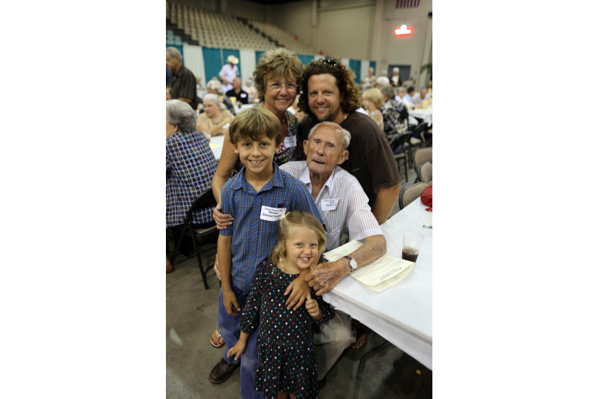 "Bob Parker, Sr., 98, the oldest male ""pioneer"", poses with his daughter, Brenda Parker-West, grandson, David Damschroder and grandchildren Nolan Damschroder, 9, and Josie Damschroder, 3."