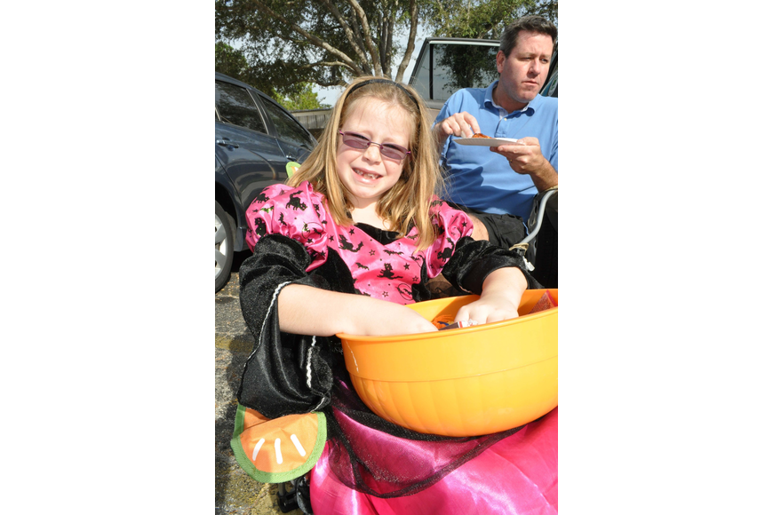 Hannah Van Hise, 7, held off on her pizza dinner so she could keep passing out candy.