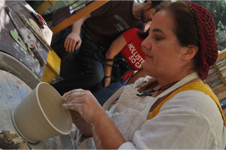 Susan Kennedy demonstrates how to make pottery.