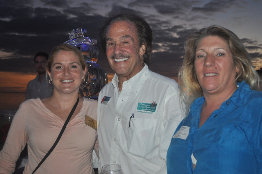 Tammy Angel (left) and Teresa Alexander of Dieter's Sod Service, with Richard Perlman of Michael Saunders