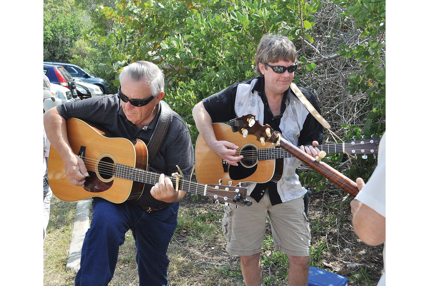 Roger Schauer and Marty Girsch warm up before performing at Benny Kimsey's Bluegrass Picnic March 10, at the Turtle Beach Pavilion.