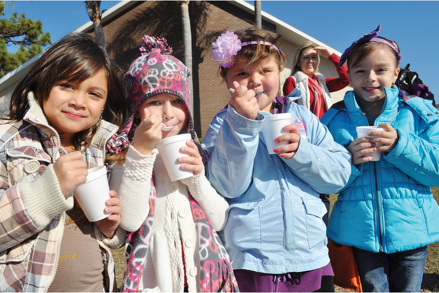 Students Alana Kutt, Kylee Pavkovich, Abby Mosher and Mariela Cheno enjoyed snow cones as they watched their friends sled at the Tabernacle Christian School's Winter Wonderland celebration Jan. 30. Published Feb. 2, 2012.