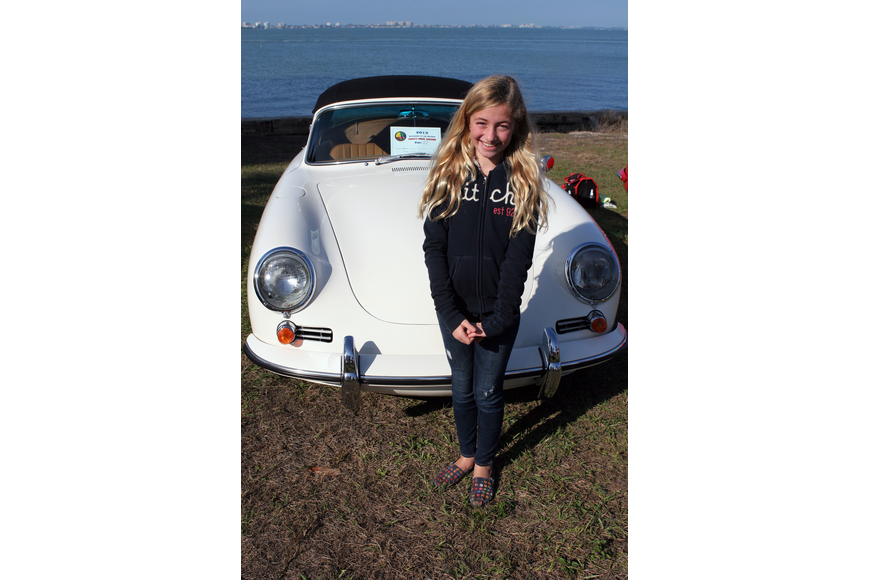 Jacqueline Hennecke, 10, poses in front of her parents Porsche.