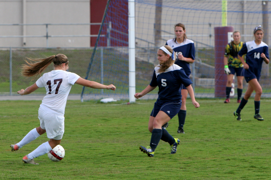 Riverview's Katy Mixon, No. 17, heads towards the goal while North Port's Jenna Staub, No. 5, tries to block her Saturday, Jan. 12, at Riverview High School.