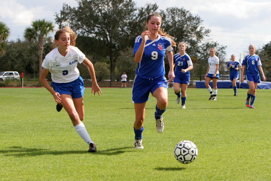 Sarasota Christian's Taylor Smith, No. 9, and Northside Christian's Briana Meehan, No. 9, run after the ball.