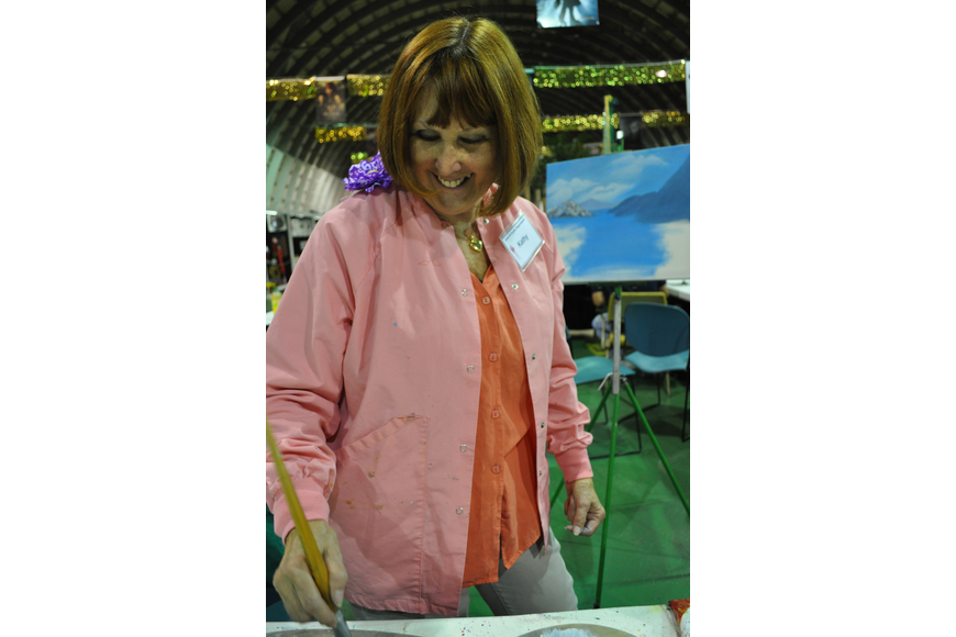 Kathy Rodd demonstrated how to paint a landscape. She was stationed in the craft section of the fair.