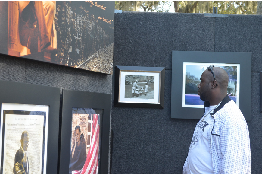 Alford Sanders looks over The Long Road, an exhibit by The Human Spirit Foundation.