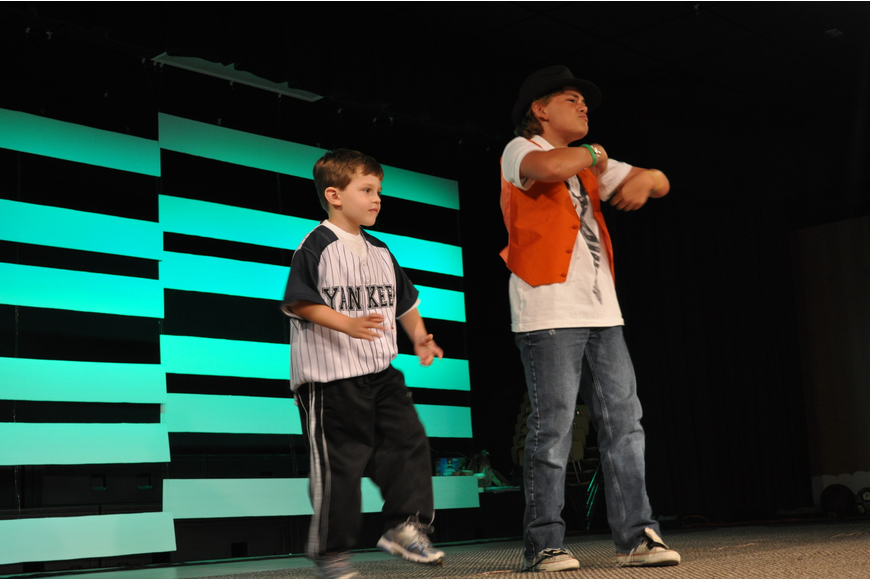 In a cameo performance, five-year-old Nico Juliano, who attends Braden River Elementary, abruptly hopped on stage to dance with Waxler.