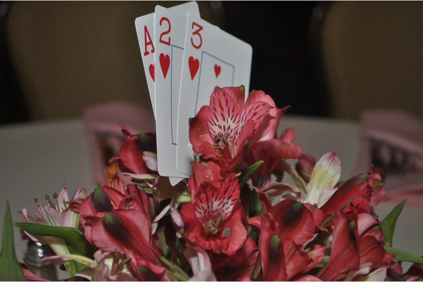 Centerpieces included alstroemeria and playing cards.