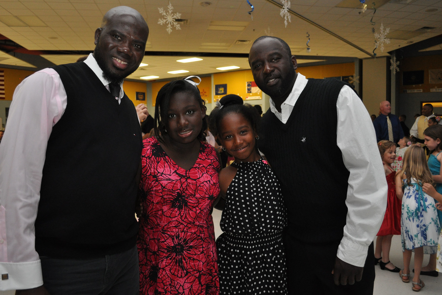 Rotimi Fakayod and his daughter Ayonna Jackson, with Aniya Tribue and her father, Leith Kenon