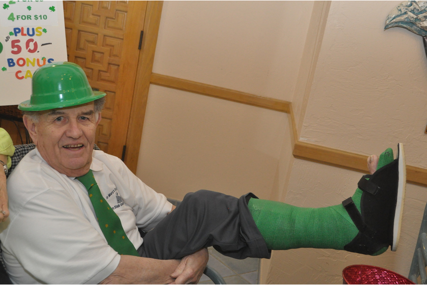 Jack McManus sports a green cast after his ankle replacement surgery.