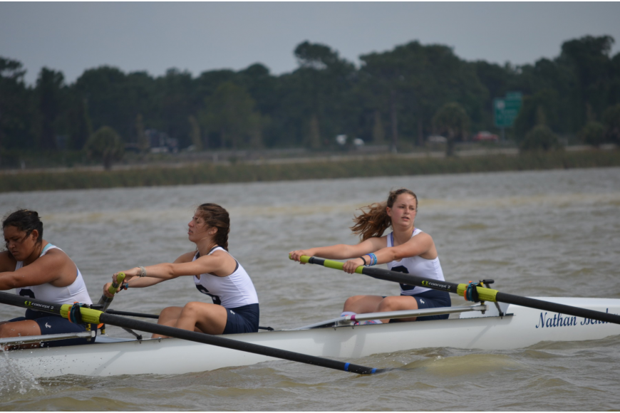 Sarasota Crew rowers Logan Gerhardt, Sidney London and Libby Oliveri row to the starting line.
