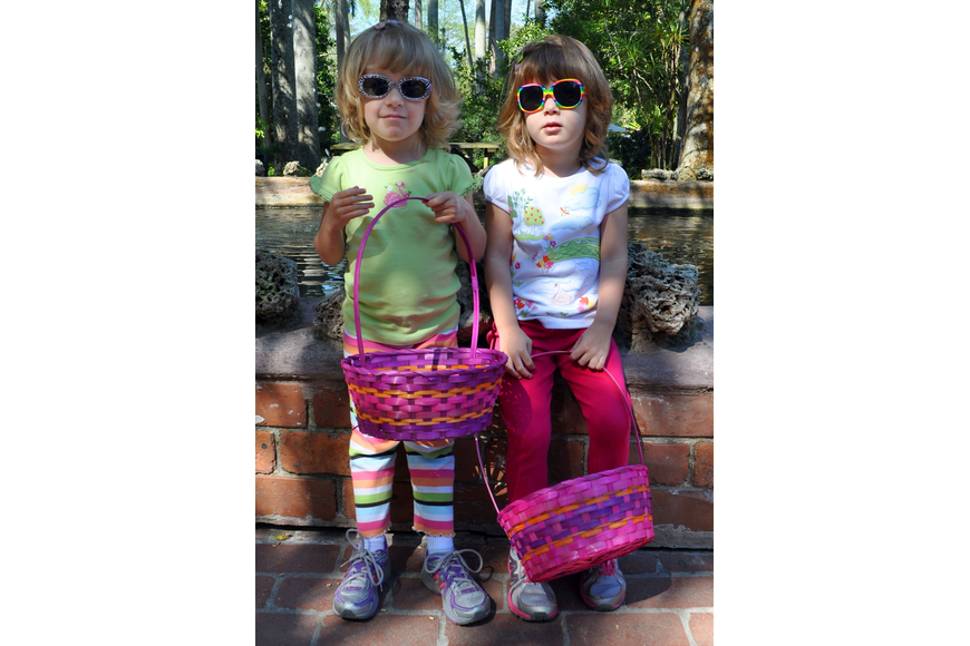 Angela and Kimberly LaVick, 3, wearing their fun sunglasses and carrying their Easter baskets.