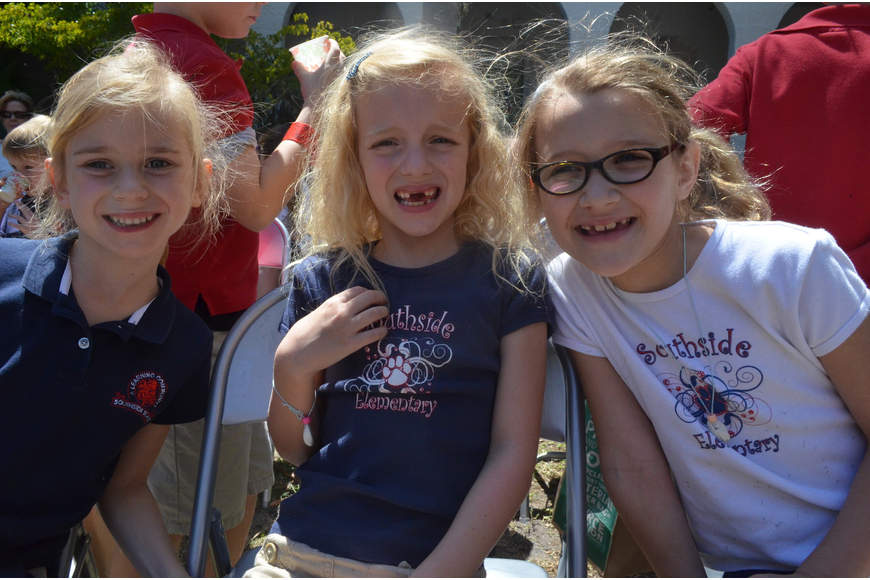 First graders Esmee Dieckman, Serena Beaty and Kylie Giasson get ready to watch a presentation from the Sarasota Jungle Gardens.