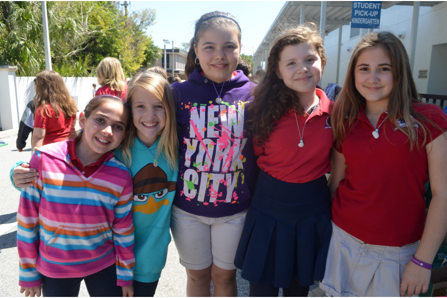 Fifth graders Skyler Metnick, Victoria Meyer, Abby Nations, Nicole Jolly and Lydia Wachob get ready to participate in the corn hole toss.