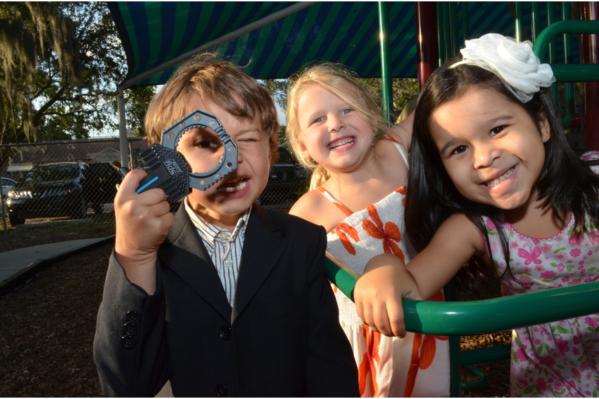 Quenton Newcomb, Addie Litherland and Sofia Beau play on the jungle gym after graduating from preschool.
