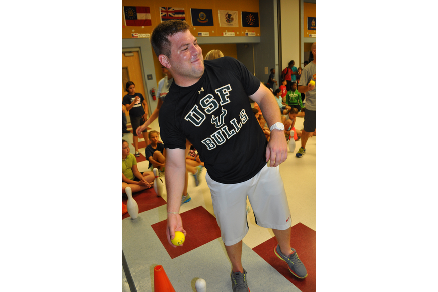 Teacher Mark Wojcicki shows off his aim, during a match-up against fifth-grade students.