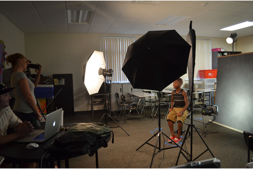 Thirteen-year-old Jeremiah Williams gets his school portrait taken by Booth Studio.