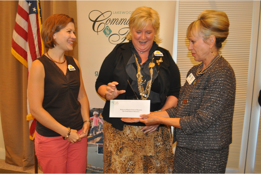Kristen Theisen and Maribeth Phillips accepted a $2,000 grant for Meals on Wheels PLUS from Diane Brune of the Lakewood Ranch Community Fund.