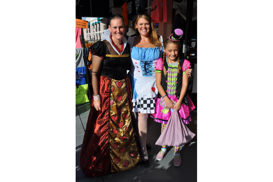 Kris Weccele, Lori Major and Kristina Seeley, 10, show off their Alice in Wonderland outfits.