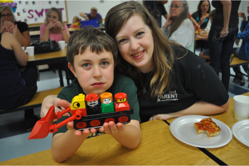 Holly McAndrew, PTO vice president, with her fourth-grade son, Thomas