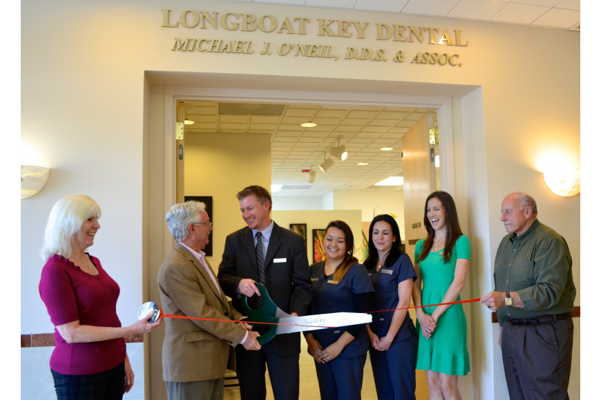 Mayor Jim Brown, Dr. Michael O'Neil and his staff laugh as the scissors fail to cut the ribbon.