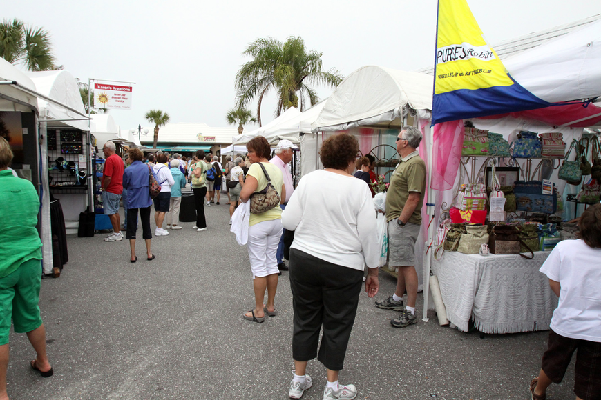 The crowd makes it way through all the booths at the 17th annual Siesta Key Craft Festival Saturday, Feb. 5, in Siesta Key Village.