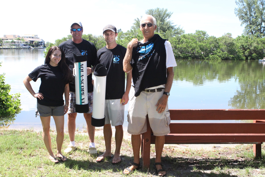 Amanda Dominguez, Steve Harris, Chris Wetzig and Bob Clousson model their seagrass team shirts Saturday, July 30 out by the water at the Turtle Beach Community Center