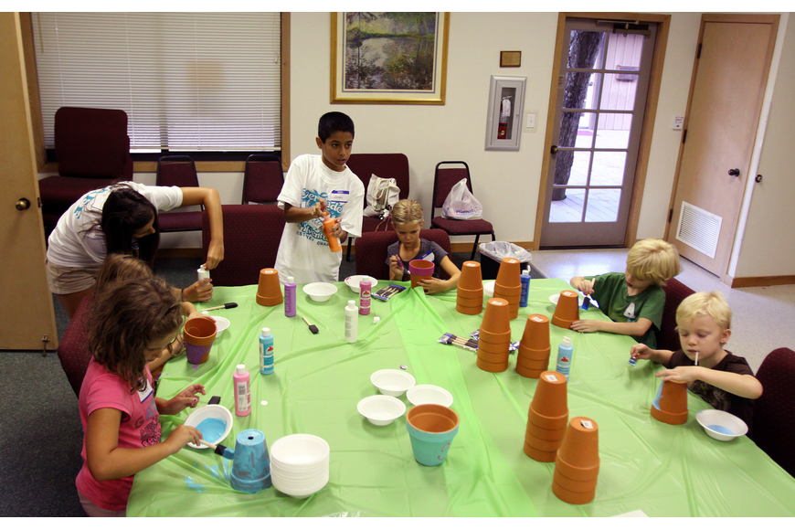 The Herons were the first group to work in the craft room Monday, August 8 during vacation bible school at Siesta Key Chapel. The group painted flower pots and will be planting seeds in their pots later in the week.