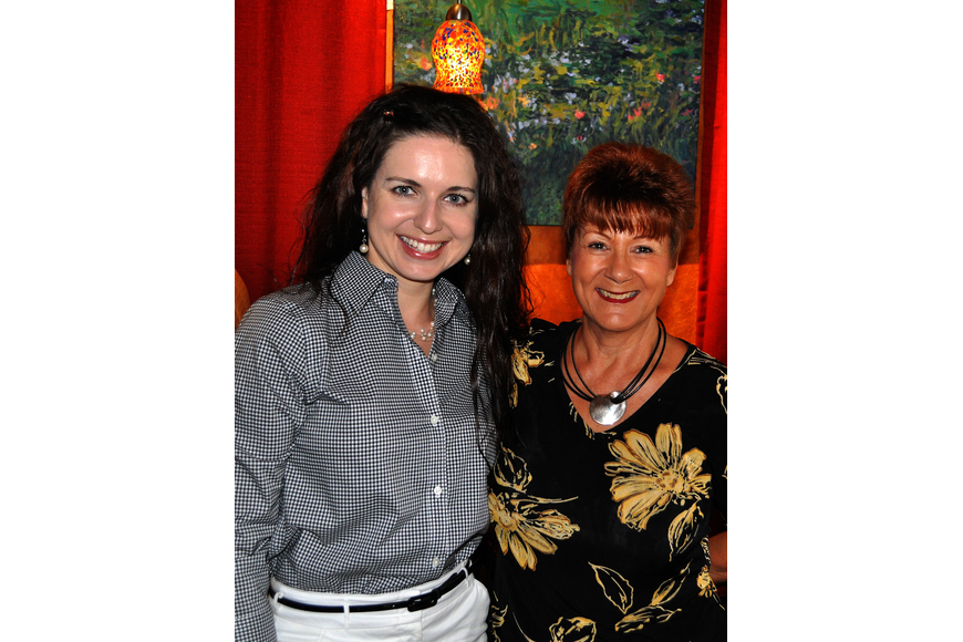 Olga Ovchiyan and Nelly Camardo pose together Tuesday, Sept. 6 during the YES luncheon at Clayton's Siesta Grille on Siesta Key.